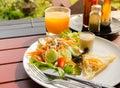 Vegetable salad with fried egg,orange juice Royalty Free Stock Photo