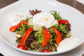 Vegetable salad with poached egg Stock Photos