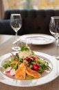 Vegetable salad on restaurant table appetizer with fried cheese Royalty Free Stock Image