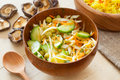 Vegetable salad in rustic bowl wooden on kitchen table Stock Image