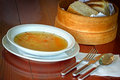 Vegetable soup and bread on a table Royalty Free Stock Photos