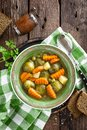 Vegetable soup with brussel sprouts on wooden rustic table Royalty Free Stock Photo