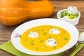 Vegetable soup cream with pumpkin, rice and green peas Royalty Free Stock Photo
