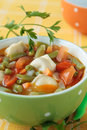 Vegetable soup with dumplings meat green beans peas tomatoes peppers Royalty Free Stock Images