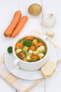 Vegetable soup meal with vegetables and baguette