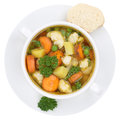Vegetable soup meal with vegetables in bowl from above isolated