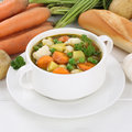Vegetable soup meal with vegetables, potatoes, carrots healthy e