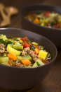 Vegetable soup with mincemeat green bean potato leek carrot tomato and parsley served in brown bowls selective focus focus in the Royalty Free Stock Photo