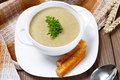 Vegetable soup with parsley and fried bread on a wooden table. Royalty Free Stock Photo