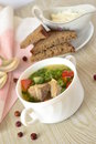 Vegetable soup with red fish selective focus vertical Stock Photo