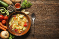 Vegetable stew fresh on wooden background overhead shoot Stock Photo