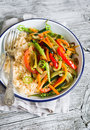 Vegetable stir-fry and rice in an enamel plate Royalty Free Stock Photo