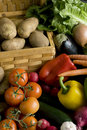 Vegetables around basket Stock Photo