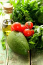 Vegetables avocado tomato olive oil and herbs still life of fresh Stock Photos