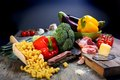 Vegetables, bacon and cheese for cooking pasta. Royalty Free Stock Photos