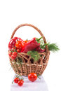 Vegetables in the basket ripe tomatoes and red pepper on a white background Royalty Free Stock Image