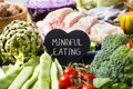 Vegetables, chicken and text mindful eating Royalty Free Stock Photo