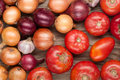 Vegetables crop background onions garlic tomatoes top view Royalty Free Stock Photo