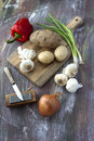 Vegetables and a cutting board fine art image of assorted some utensils Stock Photo