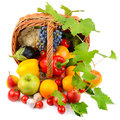 Vegetables and fruits in a basket isolated on white Royalty Free Stock Photo