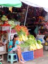A vegetables and fruits vendor girl sitting and waiting buyer