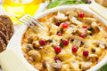 Vegetables gratin with mushrooms and cranberries Stock Photography