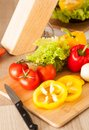 Vegetables and knife on cutting board Stock Photography