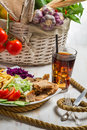 Vegetables and meat kebab served with fries and a coke on old wooden table Stock Photography