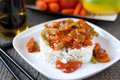 Vegetables and meat in sweet and sour sauce pineapple chicken with rice garnish Royalty Free Stock Photos