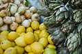 Vegetables - onions, lemons and artichoke Royalty Free Stock Images