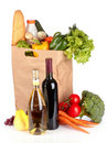 Vegetables in paper bag and wine bottles isolated Royalty Free Stock Images