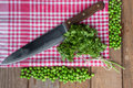 Vegetables parsley and peas on kitchen rag Royalty Free Stock Images