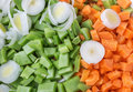 Vegetables peas and carrots Slicing for salad and soup. Royalty Free Stock Images