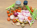 Vegetables quail eggs and raw chicken wings closeup fresh on wooden background horizontal photo Royalty Free Stock Photo