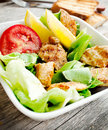 Vegetables salad with grilled chicken breast homemade caesar and toast Stock Photography