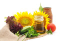 Vegetables and sunflowers on sacking. Royalty Free Stock Photo