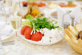 Vegetables on table plate with tomato onion and cream Royalty Free Stock Photo