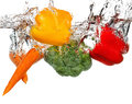 Vegetables in water splash. Isolated on white background Royalty Free Stock Photo