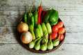Vegetables on a wooden hreshing basket Royalty Free Stock Images
