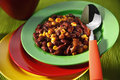 Vegetarian chili con carne on colorful plates Royalty Free Stock Photo