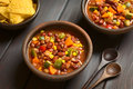 Vegetarian chili dish made with kidney bean carrot zucchini bell pepper sweet corn tomato onion garlic with tortilla chips on the Royalty Free Stock Photos