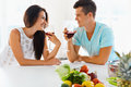 Vegetarian couple drinking red wine in the kitchen Royalty Free Stock Photo