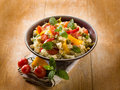 Vegetarian couscous tofu capsicum tomatoes mint capers Stock Photo