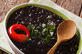 Vegetarian food: spicy black beans close up in a bowl. horizonta Royalty Free Stock Photo