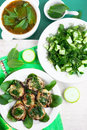 Vegetarian green dinner vegetable soup fried vegetable marrow and salad Royalty Free Stock Images