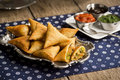 Vegetarian indian samosas with dipping sauces are made from vegetables meat or a combination of the two wrapped in dough triangles Royalty Free Stock Image