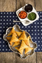 Vegetarian indian samosas with dipping sauces are made from vegetables meat or a combination of the two wrapped in dough triangles Stock Images