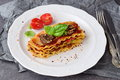 Vegetarian lasagna with mushrooms, onions, olives and tomato sauce on a white plate. Healthy eating concept Royalty Free Stock Photo