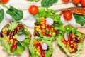 Vegetarian meal healthy food vegetarian sandwich eating on table Stock Photos