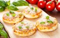 Vegetarian mini pizzas homemade served on a wooden board Stock Images